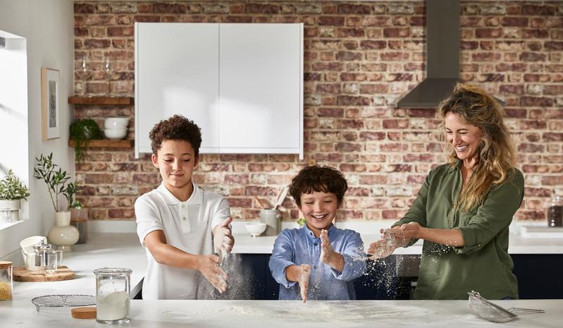 kids-having-fun-with-kenwood-hand-mixer-flour